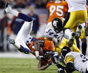 Kenny McKinley is tackled during a game vesus the Pittsburgh Steelers in 2009. (AP Photo/Jack Dempsey)