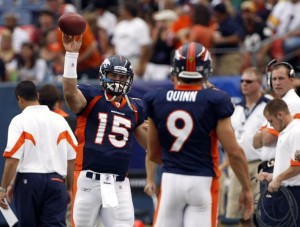 Tim Tebow throws to Brady Quinn before facing the Pittsburgh Steelers. (REUTERS/Rick Wilking)