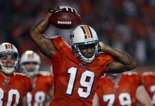 Wide receiver Brandon Marshall celebrates his first touchdown as a Miami Dolphin against the New York Jets during third quarter NFL football action in Miami, Florida September 26, 2010.   (REUTERS/Carlos Barria)