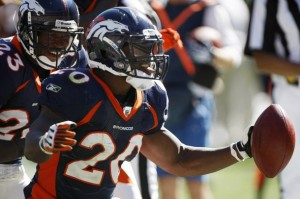Denver Broncos safety Brian Dawkins (20) celebrates intercepting a pass from Seattle Seahawks quarterback Matt Hasselbeck in the second quarter with teammate Renalso Hill (L) during their NFL football game in Denver September 19, 2010. (REUTERS/Rick Wilking)
