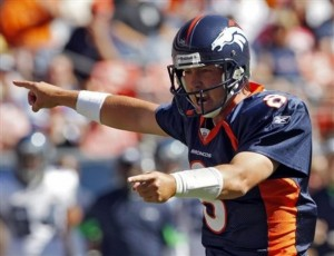 Denver Broncos quarterback Kyle Orton calls a play at the line of scrimmage against the Seattle Seahawks during the first half of an NFL football game Sunday, Sept. 19, 2010, in Denver. (AP Photo/Ed Andrieski)