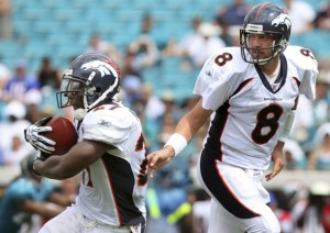 Denver Broncos quarterback Kyle Orton hands the ball off to Knowshon Moreno (L) during the third quarter of their NFL football game against the Jacksonville Jaguars in Jacksonville, Florida September 12, 2010. (REUTERS/Daron Dean)