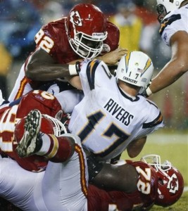 San Diego Chargers quarterback Philip Rivers (17) is sacked by Kansas City Chiefs defensive end Wallace Gilberry (92), linebacker Tamba Hali (91) and defensive end Glenn Dorsey (72) during the first half of an NFL football game Monday, Sept. 13, 2010, in Kansas City, Mo. (AP Photo/Ed Zurga)