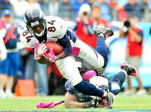 Michael Griffin #33 of the Tennessee Titans loses his helmet as he tackles Brandon Lloyd #84 of the Denver Broncos at LP Field on October 3, 2010 in Nashville, Tennessee. Denver won 26-20.  (Photo by Grant Halverson/Getty Images)