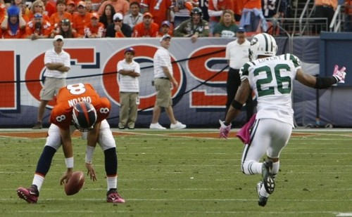 Kyle Orton can't recover a fumbled snap late in the fourth quarter against the New York Jets. (Reuters - Rick Wilking)
