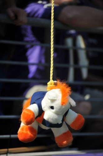 A fan of the Baltimore Ravens hangs a Bronco doll during the game against the Denver Broncos. (Photo by Larry French/Getty Images)