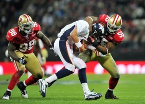 Orton is tackled by Ahmad Brooks.  Credit: Glyn Kirk - Getty Images