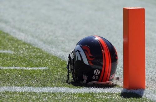 The helmets of the Denver Broncos were adorned with the #11 of recently deceased teammate Kenny McKinley as they faced the Indianapolis Colts last week. (Photo by Doug Pensinger/Getty Images)