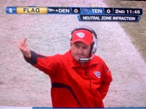 Tennessee Titans defensive coordinator Chuck Cecil flips off referees in the first quarter of their 26-20 loss to the Denver Broncos Sunday, October 3, 2010 (courtesy Twitter.com/Gunaxin)