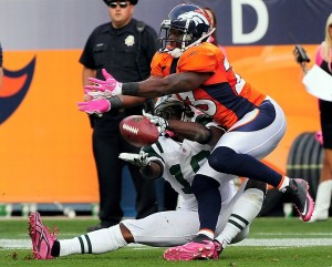 Denver Broncos defender Renaldo Hill is called for pass interference pulling on the face mask of New York Jets' wide receiver Santonio Holmes during the fourth quarter of play Sunday October 17, 2010 at Invesco Field at Mile High. Photo by Joe Amon, The Denver Post
