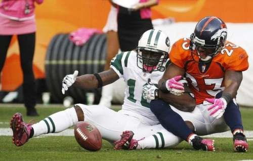 Denver Broncos safety Renaldo Hill (R) collides with New York Jets wide receiver Santonio Holmes on the one-yard-line in the fourth quarter of their NFL football game in Denver October 17, 2010. Hill was called for pass interference on the play. (REUTERS/Rick Wilking)