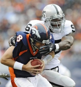 Denver Broncos quarterback Kyle Orton (8) is sacked by Oakland Raiders linebacker Kamerion Wimbley (96) during the first half of an NFL football game, Sunday, Oct. 24, 2010, in Denver. (AP Photo/ Jack Dempsey)