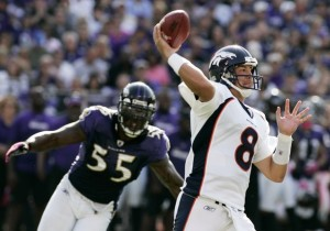 Denver Broncos quarterback Kyle Orton (R) gets off his pass as Baltimore Ravens linebacker Terrell Suggs (55) closes in during the fourth quarter of their NFL football game in Baltimore, Maryland October 10, 2010. (REUTERS/Joe Giza)