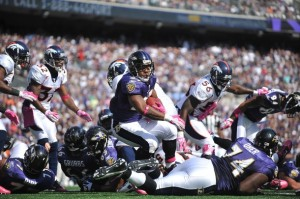 Ray Rice #27 of the Baltimore Ravens scores a touchdown against the Denver Broncos at M&T Bank Stadium on October 10, 2010 in Baltimore, Maryland. Players wore pink in recognition of Breast Cancer Awareness Month. The Ravens defeated the Broncos 31-17. (Larry French/Getty Images)