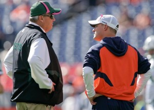 Head coach Rex Ryan of the New York Jets talks with head coach Josh McDaniels of the Denver Broncos before the game at INVESCO Field at Mile High on October 17, 2010 in Denver, Colorado.  (Justin Edmonds/Getty Images)