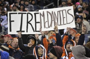 Fans hold a sign to fire Josh McDaniels during the second half of the St. Louis Rams game. (AP Photo/Joe Mahoney)