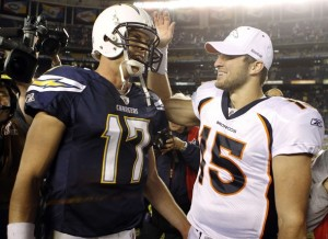 Philip Rivers is congratulated by Tim Tebow after the game (Reuters, Lucy Nicholson)