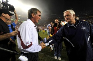Wade Phillips and Mike Shanahan shake hands after the Redskins 13-7 defeat of the Cowboys in week one. (Photo by Larry French/Getty Images)