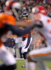 Quarterback Kyle Orton #8 of the Denver Broncos looks for a receiver against the Kansas City Chiefs at INVESCO Field at Mile High on November 14, 2010 in Denver, Colorado. The Broncos defeated the Chiefs 49-29.  (Doug Pensinger/Getty Images)