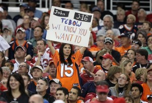 A fan holds up a sign for Tim Tebow during the game against the Arizona Cardinals. (Photo by Christian Petersen/Getty Images)