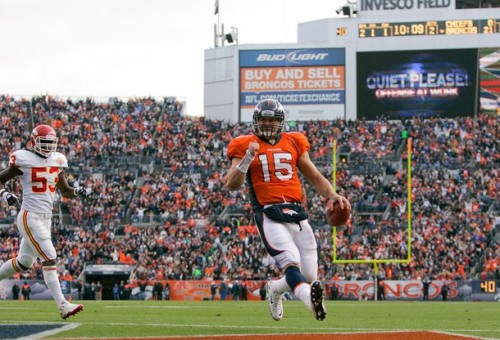 Tim Tebow scores a touchdown against the Kansas City Chiefs. (Photo by Justin Edmonds/Getty Images)