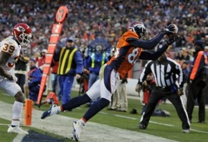 Brandon Lloyd pulls in a touchdown pass as the Broncos defeated teh Chiefs 49-29. (AP Photo Joe Mahoney)