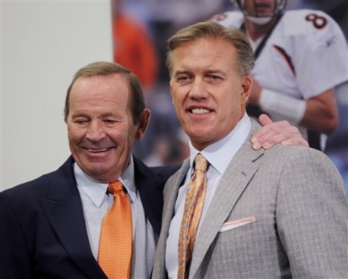 Hall of Fame quarterback John Elway and Denver Broncos owner Pat Bowlen, left, gather for a photo during an NFL football news conference at the team's headquarters Wednesday, Jan. 5, 2011, in Englewood, Colo., where Elway was named the team's executive vice president of football operations. (AP Photo/ Ed Andrieski)