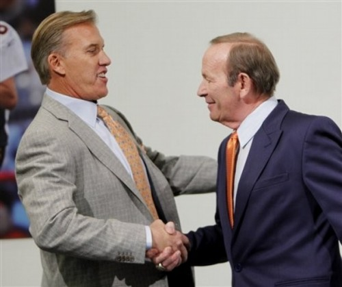 Hall of Fame quarterback John Elway, left, shakes hands with Denver Broncos owner Pat Bowlen, right, during an NFL football news conference at the team's headquarters, Wednesday, Jan. 5, 2011, in Englewood, Colo., where Elway was named the team's executive vice president of football operations. (AP Photo/ Ed Andrieski)