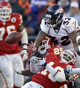 Perrish Cox crashes the Terrance Cooper/Jamaal Charles party. (AP Photo/Charlie Riedel)