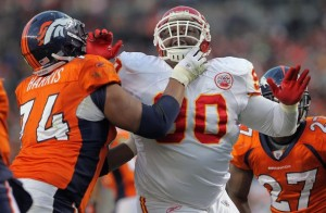 Ryan Harris defends Kyle Orton against Shaun Smith of the Kansas City Chiefs. (Photo by Doug Pensinger/Getty Images)