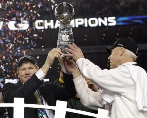 Packers president Mark Murphy and general manager Ted Thompson hoist the Lombardi Trophy after the Packers won Super Bowl XLV