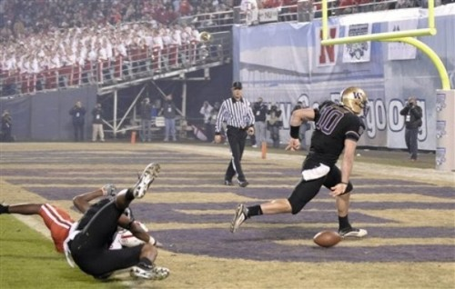 Jake Locker slams the ball in the end zone after his 25 yard touchdown run in the Holiday Bowl. (AP Photo/Denis Poroy)