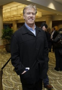 John Elway arrives for a meeting during the NFL scouting combine. (AP Photo/Darron Cummings)