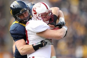 Mike Mohamed tackles a Stanford Cardinal (Photo by Ezra Shaw/Getty Images)