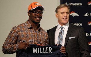 Von Miller of the Denver Broncos is presented to the media for the first time with vice president of football operations John Elway at Dove Valley on April 29, 2011 in Englewood, Colorado. Miller, a projected outside linebacker in head coach John Fox's new 4-3 scheme, was selected second overall from Texas A&M. (Justin Edmonds/Getty Images)