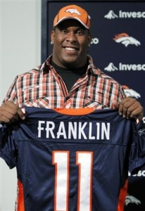 Denver Broncos second-round NFL draft pick Miami offensive lineman Orlando Franklin holds a Broncos' jersey with his name on it during a news conference at the football team's headquarters in Englewood, Colo., on Saturday, April 30, 2011. (AP Photo/Ed Andrieski)