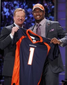 Texas A&M linebacker Von Miller, right, holds up a jersey with NFL commissioner Roger Goodell after he was selected as the second overall pick by the Denver Broncos in the first round of the NFL football draft at Radio City Music Hall Thursday, April 28, 2011, in New York. (AP Photo/Jason DeCrow)