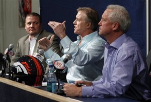 Denver Broncos vice president John Elway, center, is flanked by head coach John Fox, right, and general manager Brian Xanders during a news conference at the conclusion of the NFL Draft at the football team's headquarters in Englewood, Colo., on Saturday, April 30, 2011. (AP Photo/Ed Andrieski)