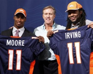 Denver Broncos vice president John Elway, center, is pictured with second round NFL draft pick Rahim Moore, left, a safety from UCLA,  and third round NFL draft pick Nate Irving a linebacker from North Carolina State, during an NFL football news conference at the team's headquarters in Englewood, Colo., on Saturday, April 30, 2011. (AP Photo/Ed Andrieski)