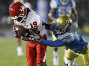 Houston wide receiver James Cleveland (19) is stopped by UCLA safety Rahim Moore (3) after a 48-yard reception in the first half of an NCAA college football game, Saturday, Sept. 18, 2010, in Pasadena, Calif. (AP Photo/Alex Gallardo)