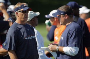 Elway & Xanders discussing an issue on the practice field.  July 28, 2011.  (Photo by Doug Pensinger/Getty Images)