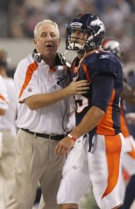 Denver Broncos head coach John Fox talks to quarterback Tim Tebow during a preseason NFL football game against the Dallas Cowboys, in Arlington, Texas. (AP Photo/LM Otero)