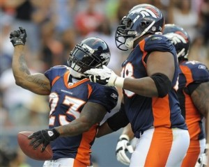 Denver Broncos running back Willis McGahee (23) celebrates with Denver Broncos offensive tackle Ryan Clady (78) after scoring a touchdown against the Buffalo Bills in the second quarter of a preseason NFL football game, Saturday, Aug. 20, 2011, in Denver.  (AP Photo/Jack Dempsey)