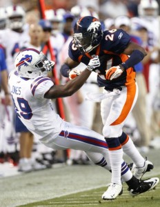 Denver Broncos safety Rahim Moore (R) throws Buffalo Bills wide receiver Donald Jones to the ground after an incomplete pass to Jones during their pre-season NFL football game in Denver August 20, 2011. Moore was penalized for unsportsmanlike conduct on the play.  (REUTERS/Rick Wilking)