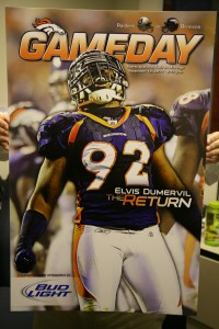 2011 season opener program cover featuring Elvis Dumervil