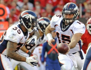 Denver Broncos quarterback Tim Tebow (R) hands off to running back Lance Ball during the second half of the Bronco's win over the Kansas City Chiefs in their NFL football game at Arrowhead Stadium in Kansas City, Missouri  November 13, 2011. REUTERS/Dave Kaup