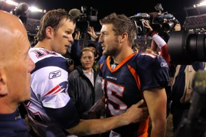 "After the game, Patriots quarterback Tom Brady was heard telling Broncos quarterback Tim Tebow ""we'll see you again."" (Photo by Doug Pensinger/Getty Images)"