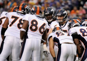 Tim Tebow Broncos huddle