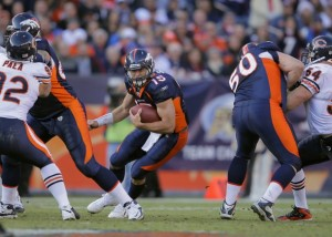 Tim Tebow #15 of the Denver Broncos runs the ball during the game against the Chicago Bears at Sports Authority Field at Mile High on December 11, 2011 in Denver, Colorado.  (Doug Pensinger/Getty Images)