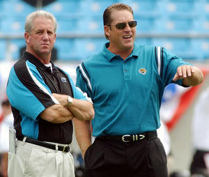 In this Sept. 7, 2003, file photo, Carolina Panthers head coach John Fox, left, talks with Jacksonville Jaguars head coach Jack Del Rio before an NFL football game in Charlotte, N.C. The Denver Broncos announced Friday, Jan. 27, 2012, they had agreed to terms with Del Rio to become the club's new defensive coordinator. The deal reunites Del Rio with Fox, who Del Rio served as defensive coordinator for with the Panthers in 2002.  (AP Photo/Mike McCarn, File)